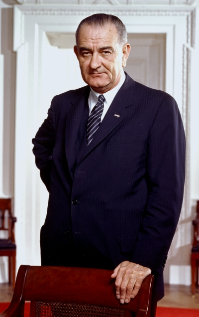 lyndon_b-_johnson2c_photo_portrait2c_leaning_on_chair2c_color_cropped